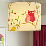 Photo of kids bedroom decor of adorable lamp shade featuring Sanderson fabric
