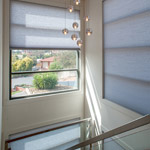 Photo of honeycomb cellular blinds as stairwell window solution