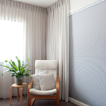 Photo of honeycomb cellular blinds coordinated with deep pinch pleated curtain sheers