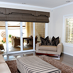 Thumb of roman blinds with shaped pelmets and plantation shutters, living room decor