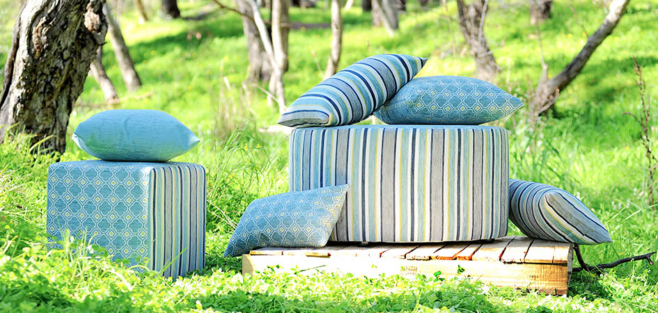 Photo of soft furnishings, ottomans and cushions in vibrant fabrics