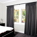Thumb of bedroom decor with pinch pleated curtains on a decorator track