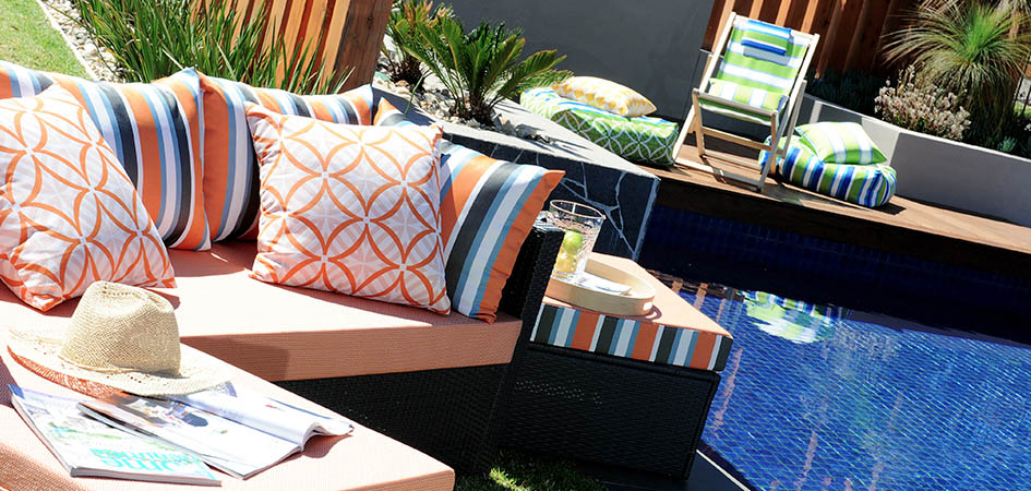 Photo of pool area with custom cushions, ottomans and beanbags