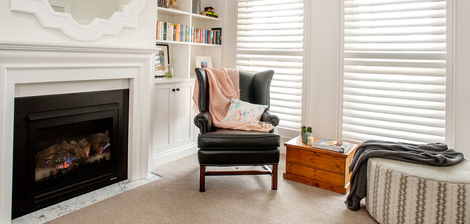 Photo of classic white timber plantation shutters in home office