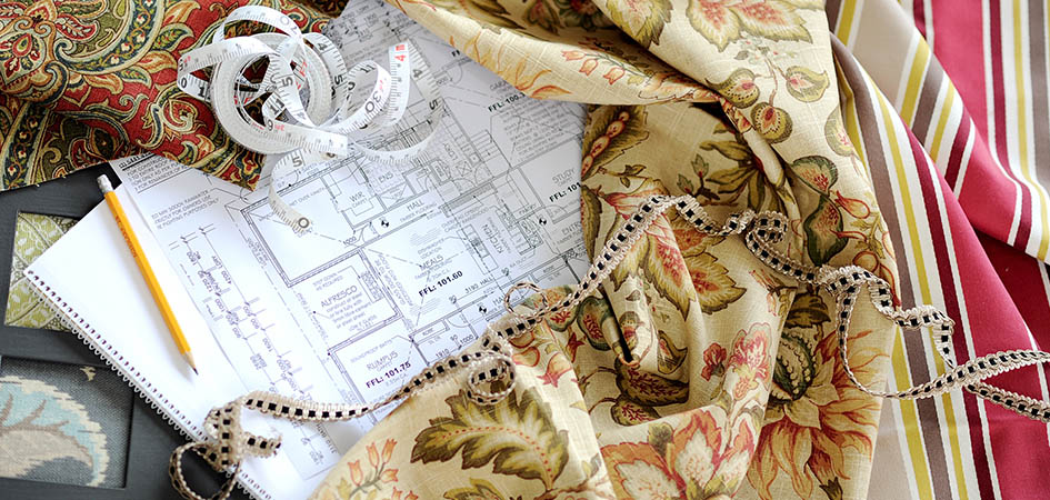 Photo of house plans and window fabric and measuring tape